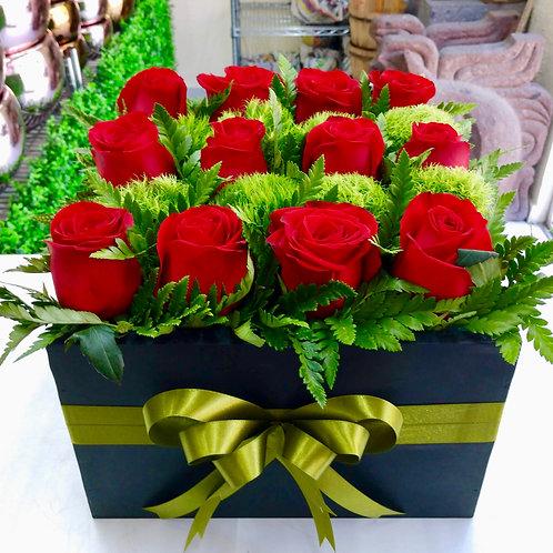 Caja de rosas rojas y green trik