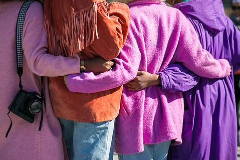 Women Backs Pink Purple Coats.jpg