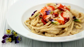 Cacio E Pepe Pasta with Butter Poached Lobster and Edible Violas