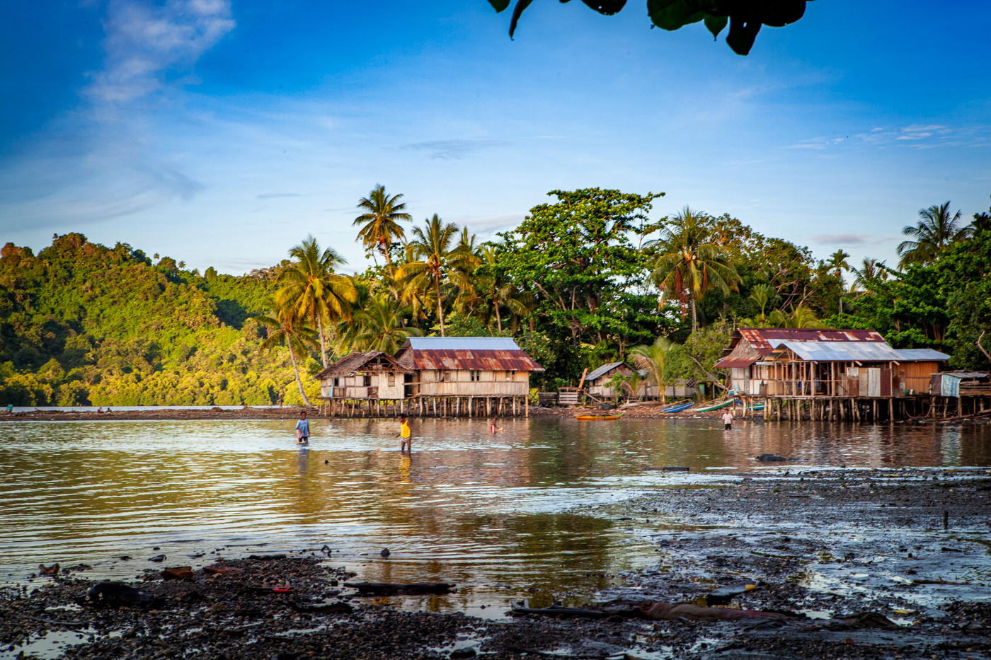 """The stunning oceanside town of Dempta, Indonesia is also home to the """"rebels"""" who oppose the 1969 """"Act of Free Choice"""" where West Papua became a part of Indonesia with the consensus of 1,000 elders from across the vast region. West Papua nationalists rejected the decision and began the Free West Papua movement."""