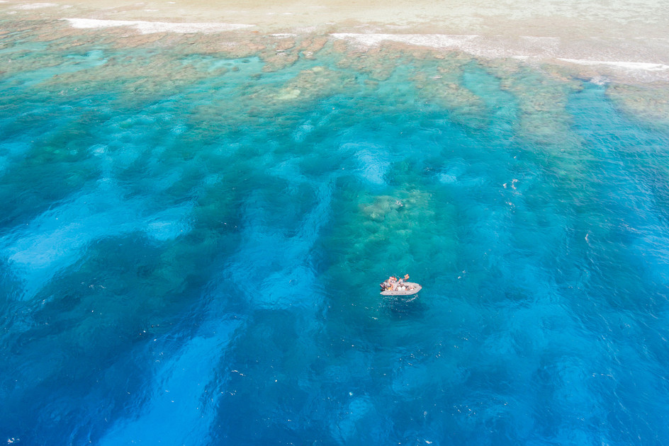 057_56Tara dinghy off of Ollan Island in Chuuk, Micronesia as scientists aboard sample water quality. Photo Credit Sarah Fretwell - Nico De La Brosse_ DJI_0024.jpg