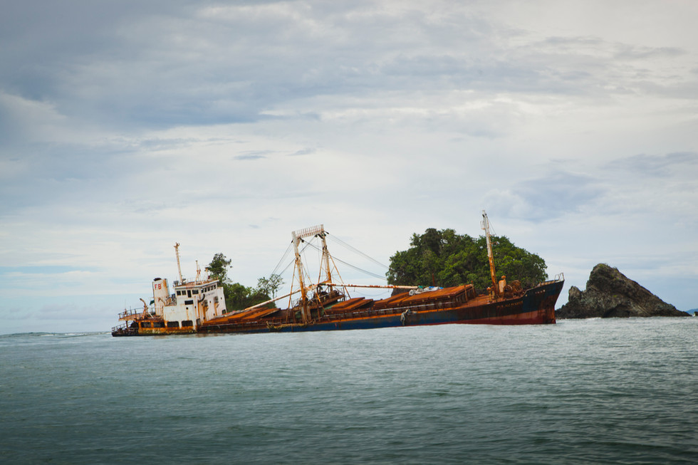 Dempta is a major port for palm nut exporting, and it is the best-paid gig in town.  This shipwreck is stuck reef during poor conditions and will most likely not be removed.