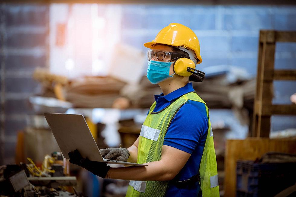 Construction-site-man-mask-laptop.jpg