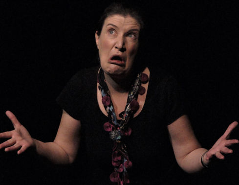 Hannah Brailsford Storyteller pulling a silly face with arms outstretched.