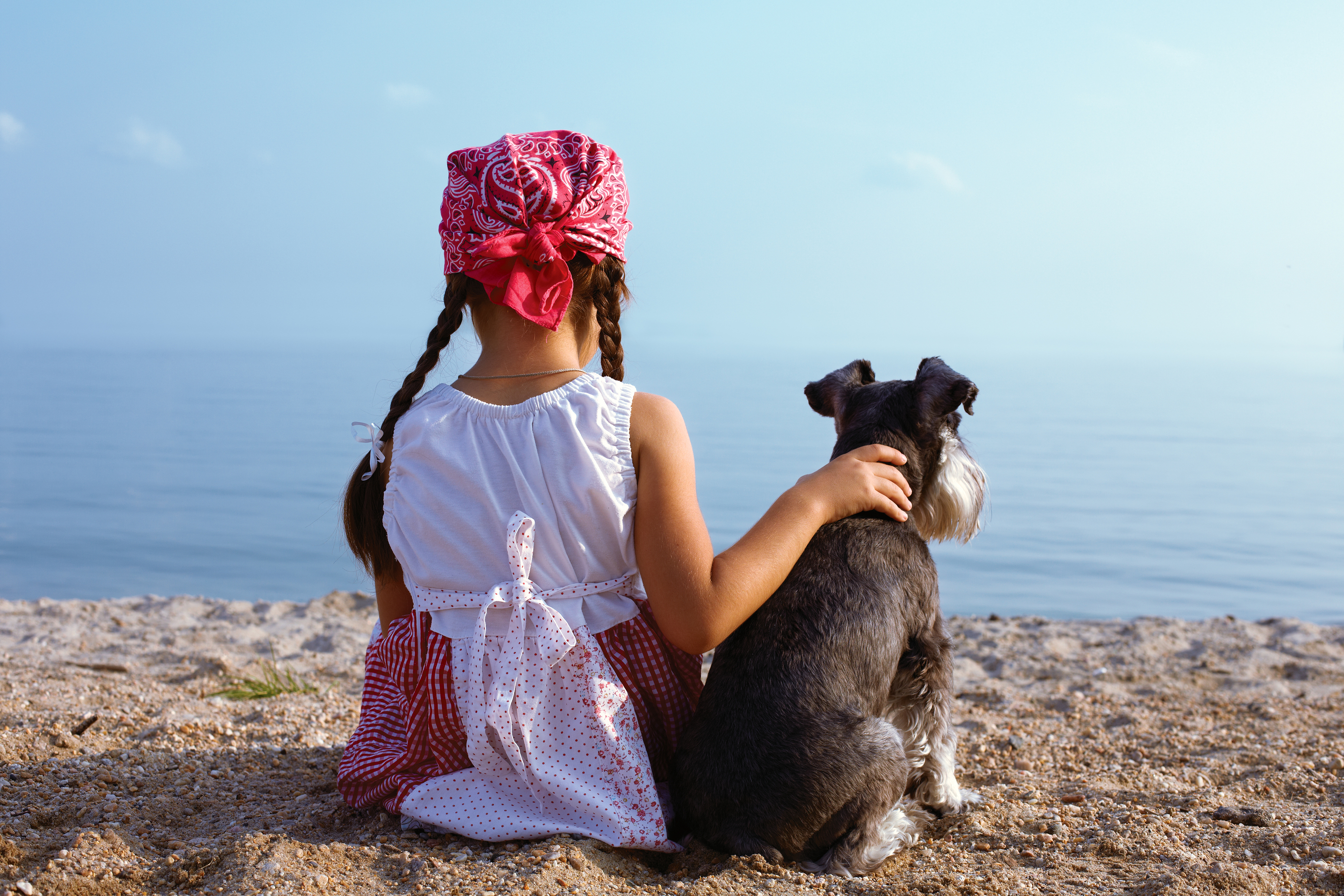 beautiful little girls embracing her dog.jpg