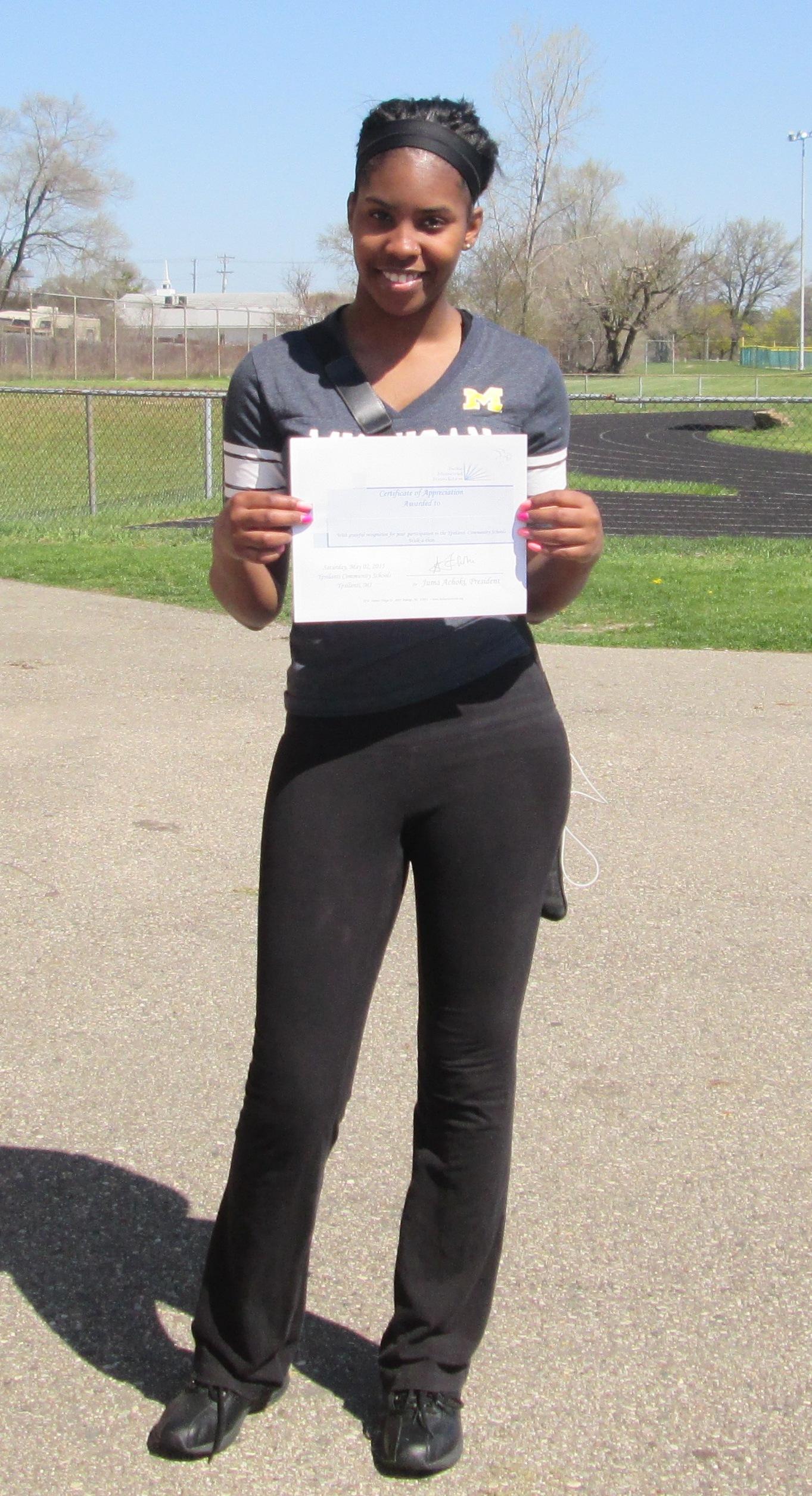 Student  shows walk certificate.JPG