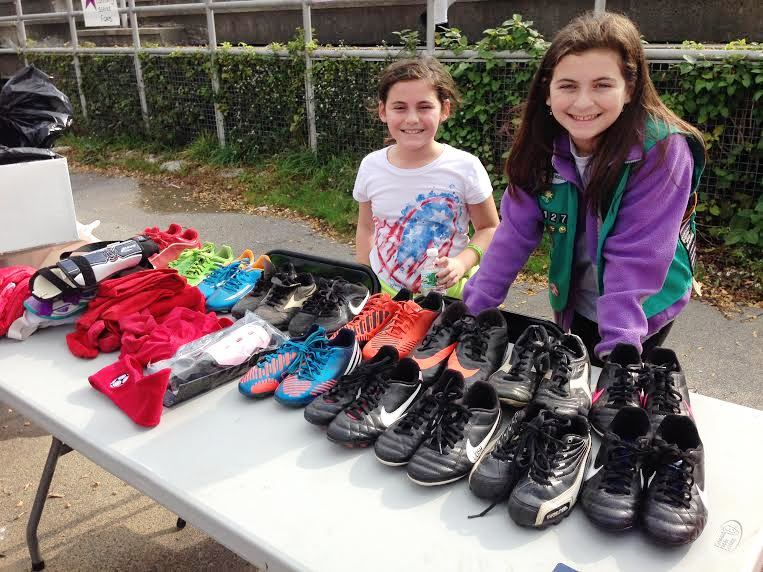 Jessi and Kara with some of the cleats she collected.jpg