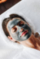 woman-relaxing-with-a-facial-mask-at-the