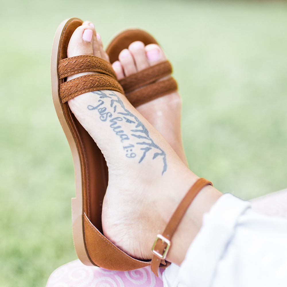 foot with tattoo of joshua 1:9