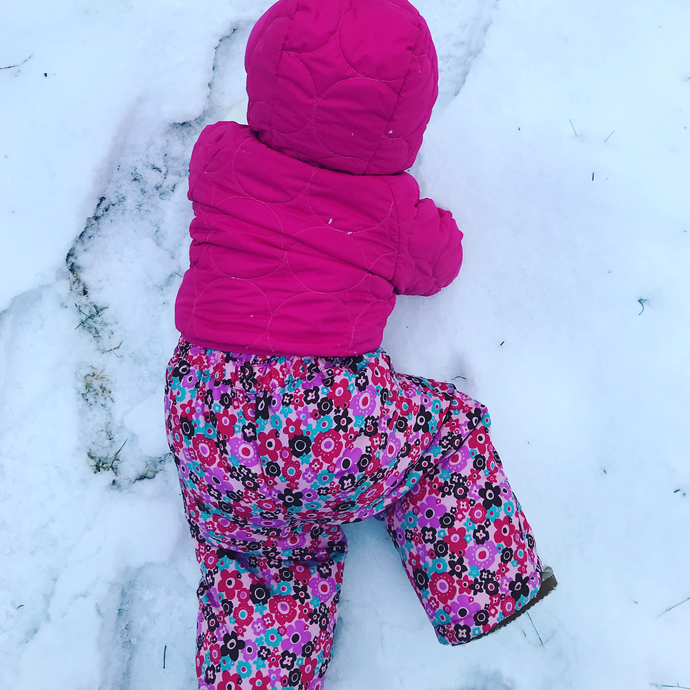 Wike Baby crawling on the snow