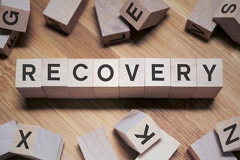Recovery Word Written In Wooden Cube.jpg