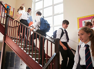 Group Of Teenage Students In Uniform Wal