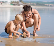 mum and son on beach.png