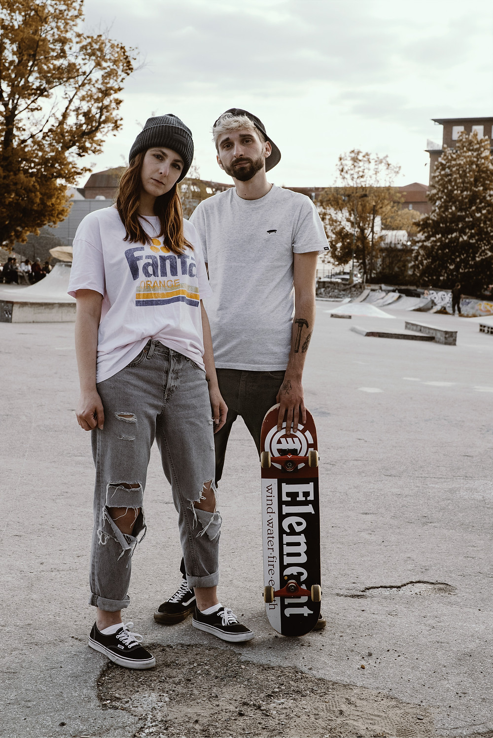 two skaters modeling at a skater parc