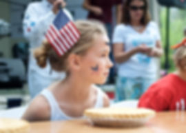 Pie eating contest at Fourth of July Arts Festival with Methow Arts.  Twisp, WA