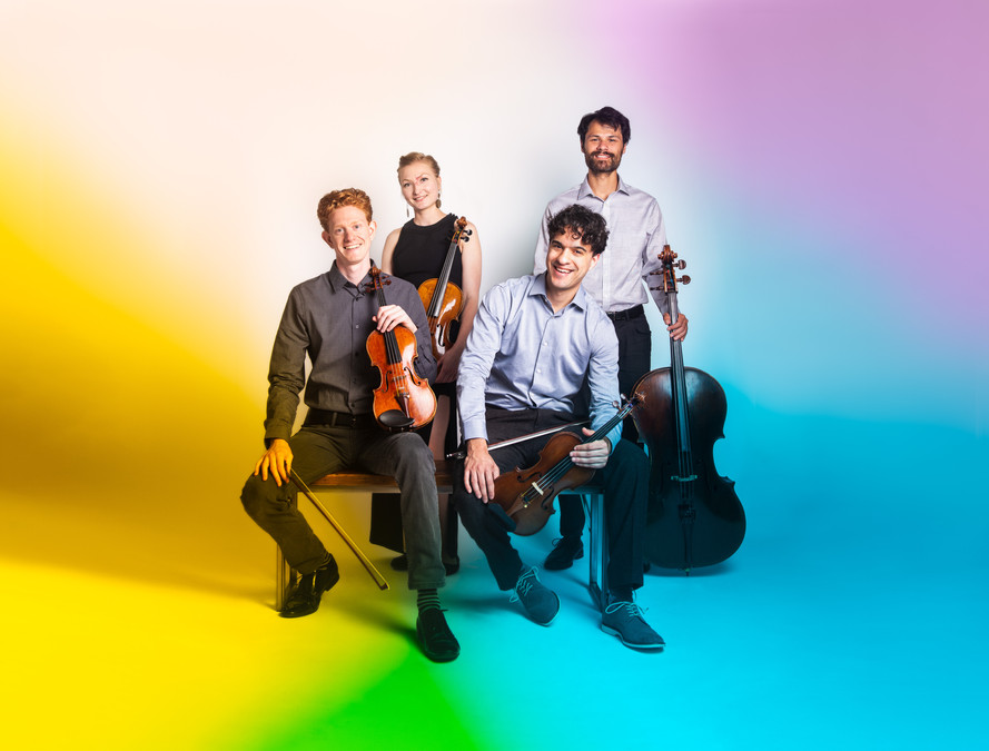 Friction Quartet poses together with their with their instruments.    Photo by Bonnie Rae Mills.