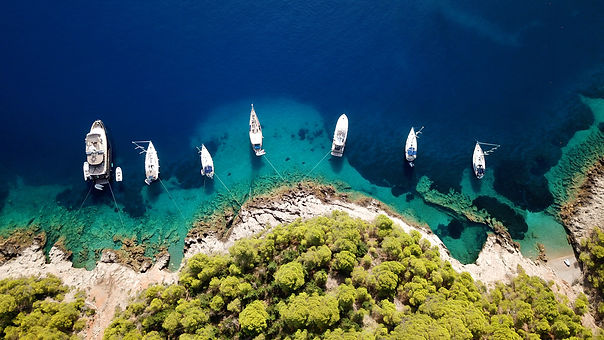 Yachts Lined Up Off Shore.jpg