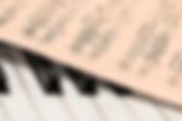 piano and music sheet.jpg