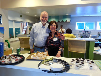 Volunteers Bob and Vanda enjoying La Jolla Community  Center event