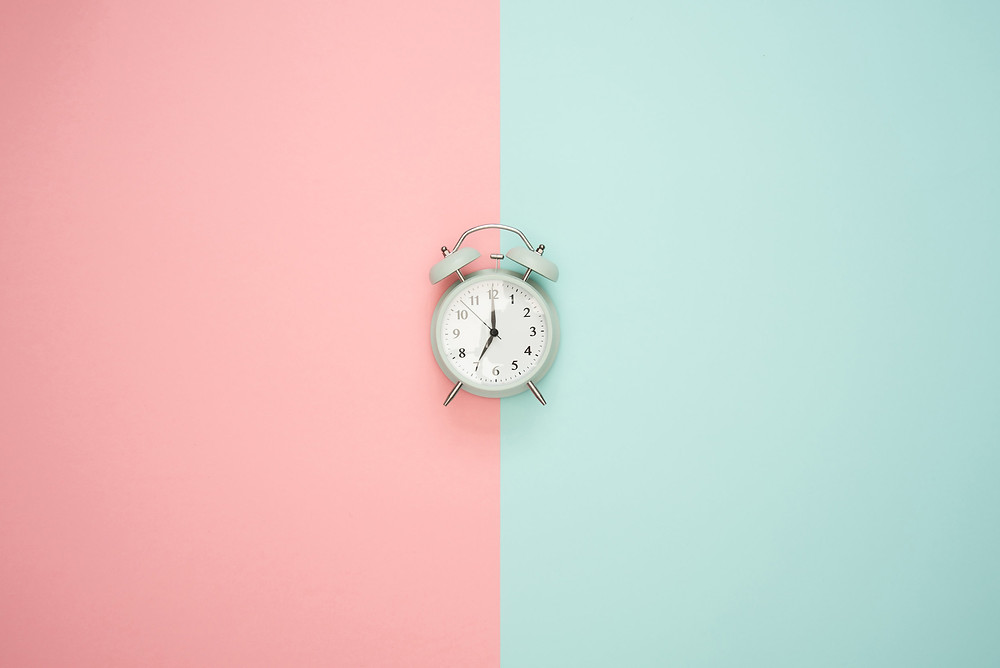 clock with blue and pink background