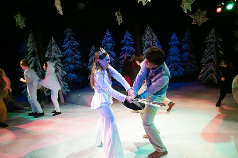 The White Queen Battles Peter with a sword made of foam, sticks and tin foil.