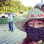 Kim wearing her hat - watermelon band an