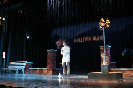 Actually raining on stage for the title number.