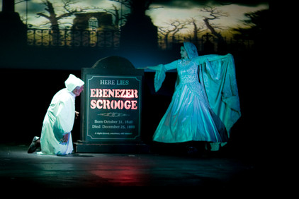 Ghost of Christmas Yet to Come shows Ebenezer Scrooge what awaits him next Christmas.