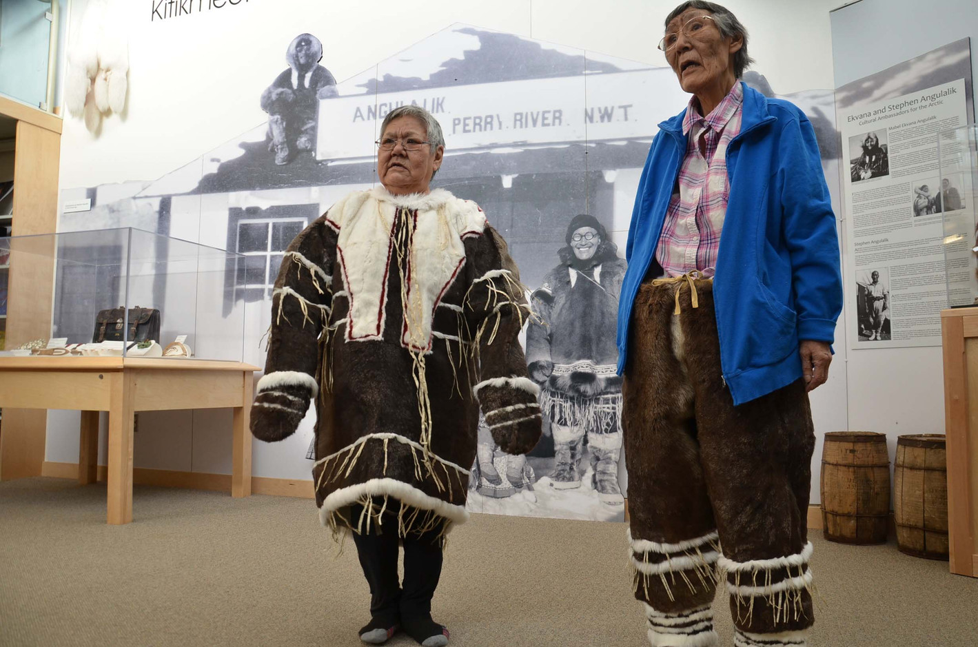 Anna Nahogaloak and Mabel Etegik model the drum dance suit they created for the exhibit. Photo by Brendan Griebel.