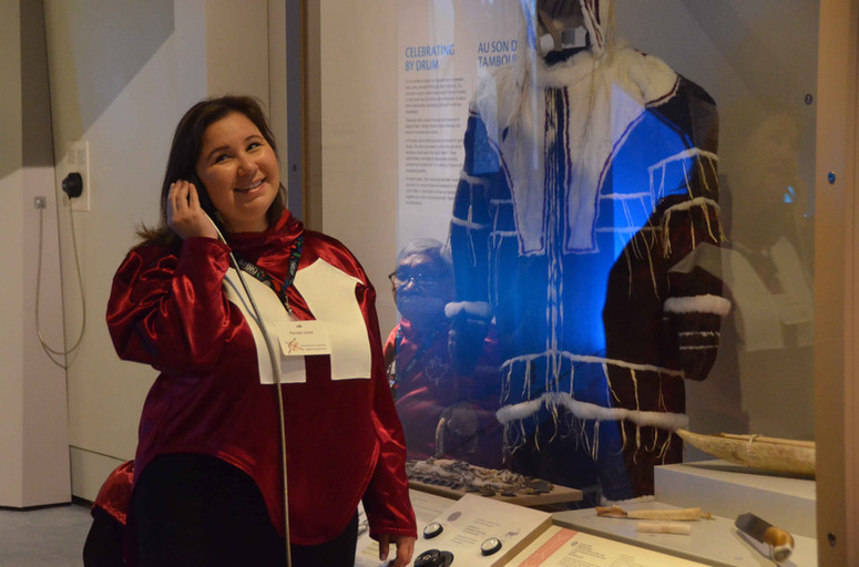 Pamela Gross listens to the Inuinnaqtun audio recordings included as part of the Inuinnauyugut exhibit. Photo by Brendan Griebel.