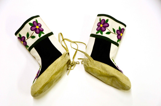 A pair of floral motif boots created by Anna Nahogaloak. Photo by Brendan Griebel.