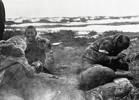 Copper Inuk man hammering out arrowheads