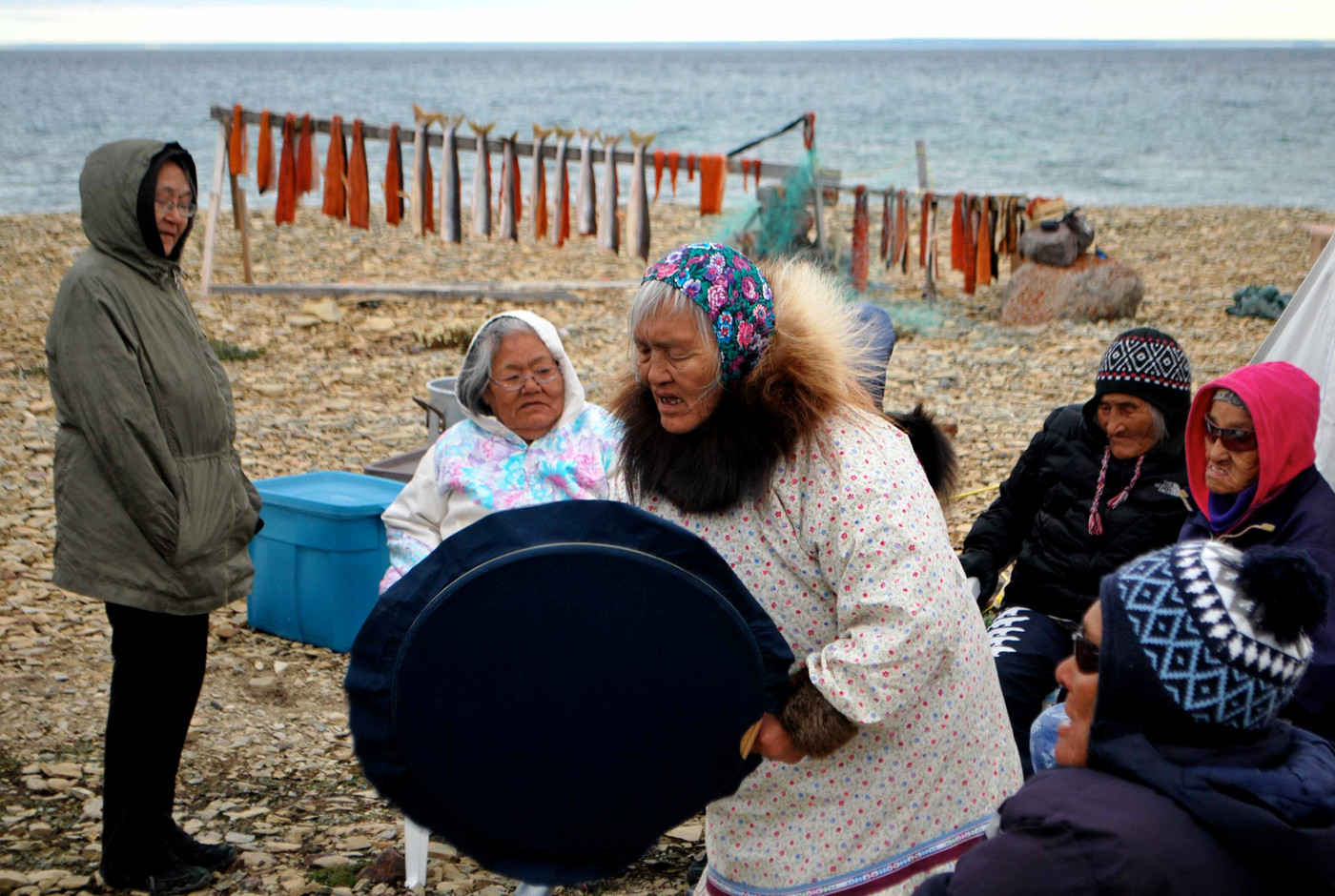 Mary Kilaodluk drum dancing at a landcamp near Cambridge Bay. Photo by Brendan Griebel.
