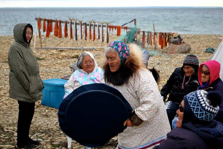 Mary Kilaodluk drum dancing at a landcamp near Cambridge Bay. Photo by Brendan Griebel.