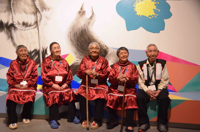 Elders attending the grand opening of the Inuinnauyugut exhibit in outfits specifically sewn for the event. Photo by Brendan Griebel.