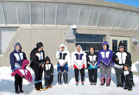 Women and children wear traditional Inuinnait style parkas they created during the KHS' Numrutiik Making Program. Photo by Pam Gross.