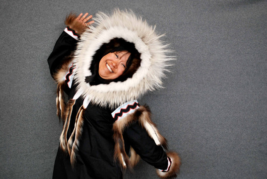 Lisa Bachellier poses with a parka sewn by the KHS Elders for Inuk singer Susan Aglukark. Photo by Brendan Griebel.
