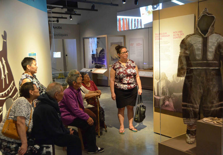 A team of Inuinnait artists and elders oversees the installation of Inuinnauyugut exhibits at the Canadian Museum of Nature. Photo by Brendan Griebel.