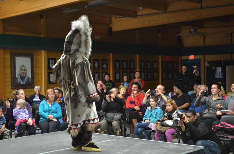 The community of Cambridge Bay models its traditional clothing during the Umingmak Frolics fashion show. Photo by Brendan Griebel.