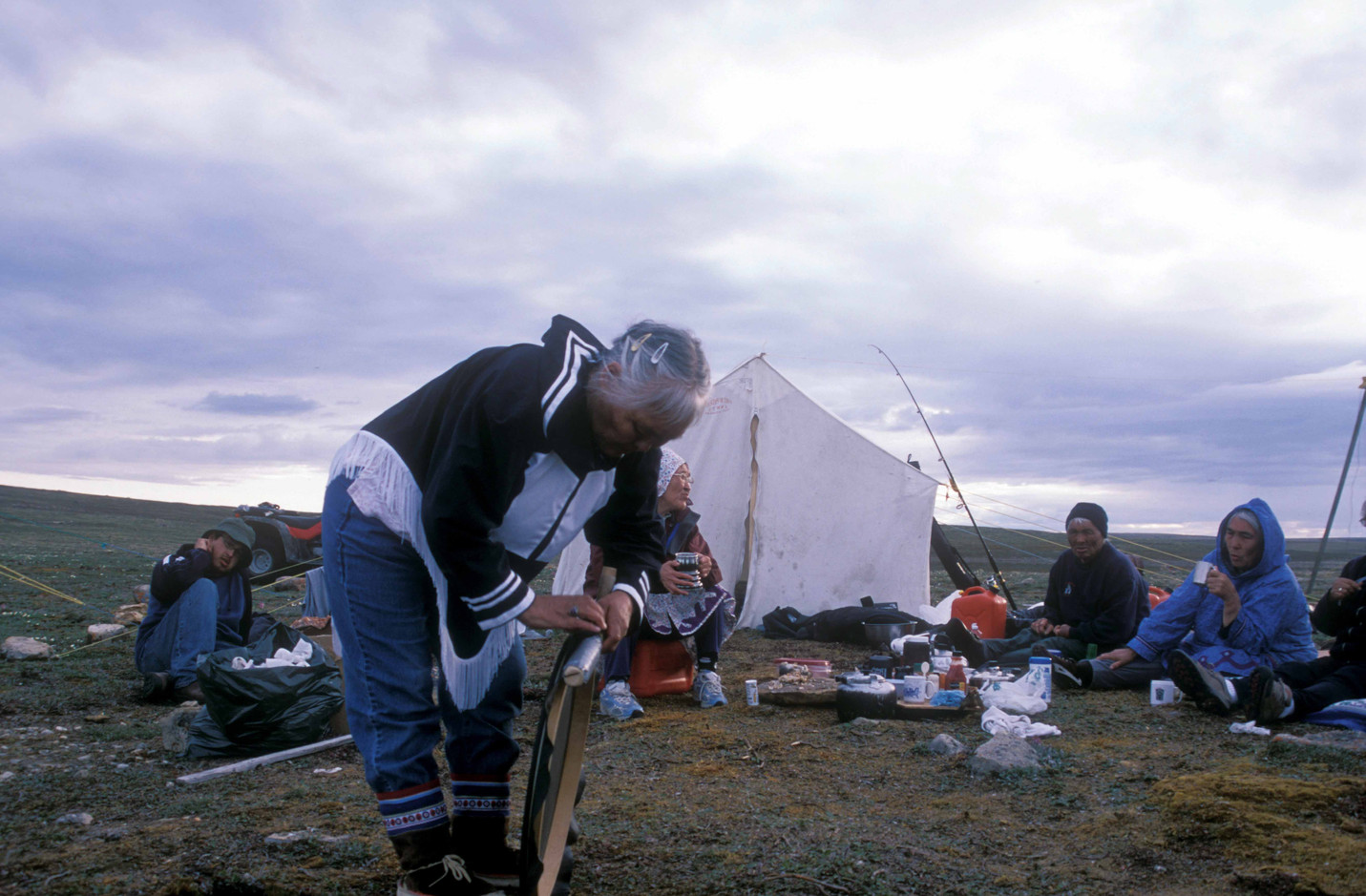 Mary Kilaodluk prepares for a drum dance at a camp near Ferguson Lake. Photo by Brendan Griebel.