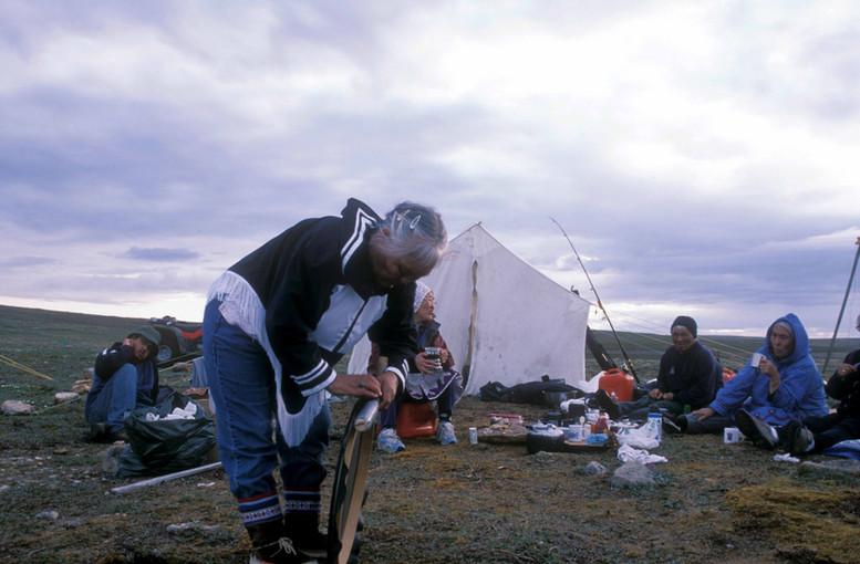 Mary Kilaodluk prepares for a drum dance at a camp near Ferguson Lake. Photo by Brendan Griebel.