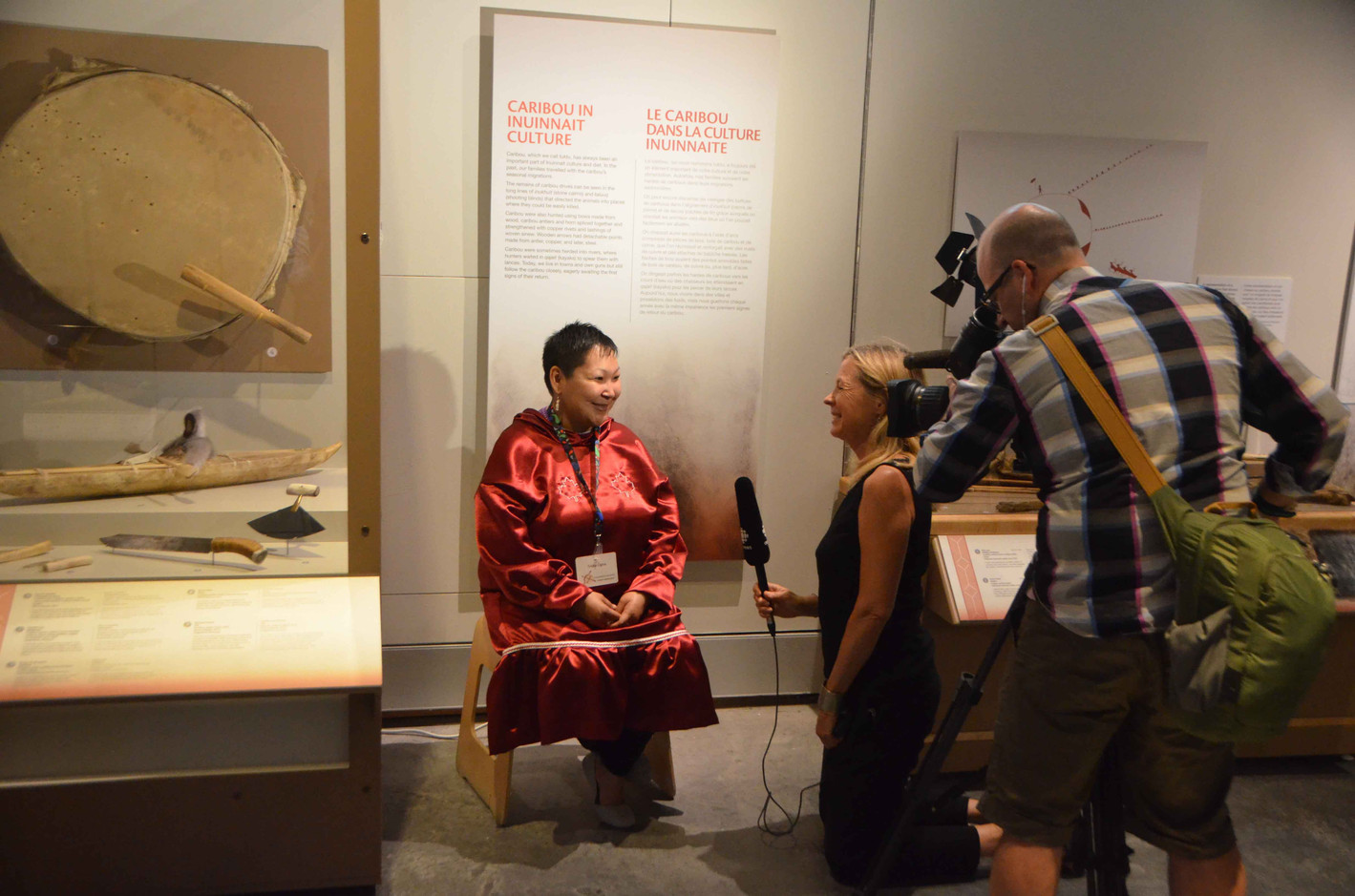 Artist Trisha Ogina is interviewed by reporters during the media preview of the Inuinnauyugut exhibit. Photo by Brendan Griebel.
