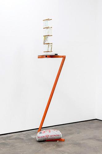 "Pretzel Tower, 2014, pretzels, ca glue, glass cement, bamboo skewers, steel stand, sandbag, tint, 28""x 16"" x 14"" (93"" x 16"" x 22"" with steel stand)"