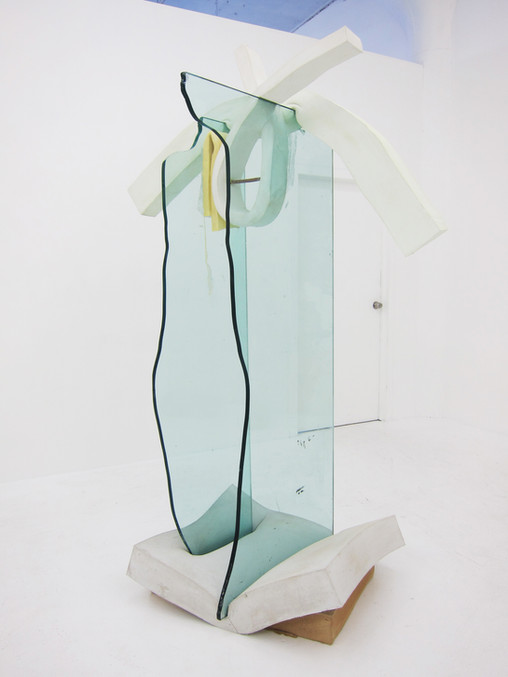 Hunky-dory, 2013, Glass, cement, polyurethane foam, ink, tint, metal, glue, pretzel, 86 x 57 x 33 inches  Freestanding tension structure uses cement-saturated foam to hold thick glass panels upright, with a pretzel as its fulcrum.