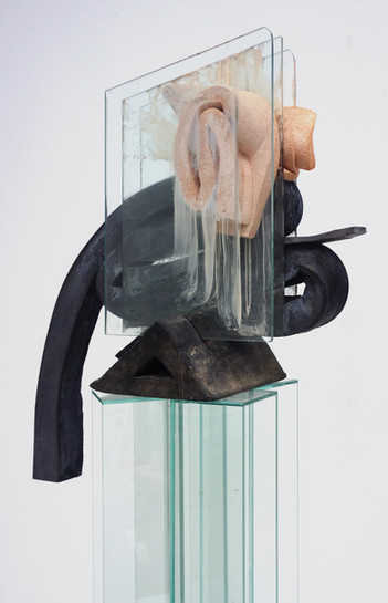 Chock, 2016, polyurethane foam, cement, glass, tape, ink, rubber chock, 51.5 x 21 x 12 inches