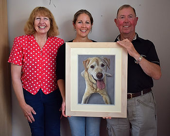 Naomi presenting dog portrait of Dylan the Golden Labrador