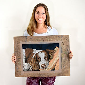 Pet portrait artist Naomi Jenkin with portrait of Charlie the English Springer Spaniel