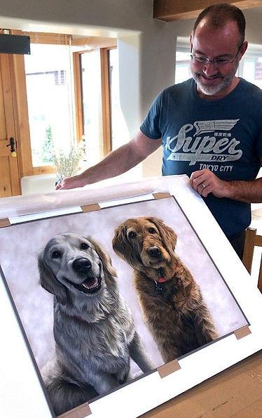 Pastel dog portrait of Beau the Golden Retriever puppy and Honey the Labradoodle. Hand drawn by pet portrait artist Naomi Jenkin.