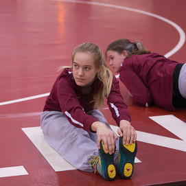 Lauren & Abby Freshmen Stretching.jpg