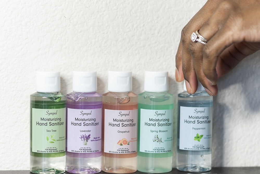Tea tree oil, lavender, grapefruit, spring blossom, and peppermint hand sanitizer lined up